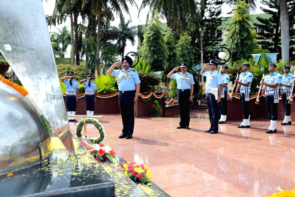 IAF Chief B.S. Dhanoa pays homage to the test crew who lost their lives, at ASTE War Memorial, in Bengaluru on May 28, 2017.