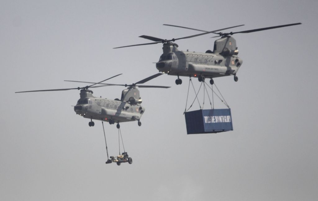 IAF's Chinook heavy lift helicopters fly past the Hindon Air Force Station during the 88th Air Force Day celebrations in Ghaziabad, Uttar Pradesh on Oct 8, 2020.