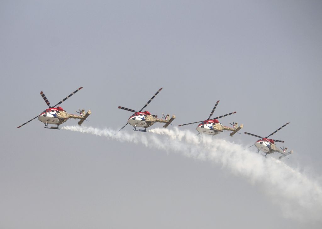 IAF's Sarang Helicopter Display team showcase aerial maneuvers during Air Force Day Parade 2020 at Hindon Air Force Station in Ghaziabad, Uttar Pradesh on Oct 8, 2020.