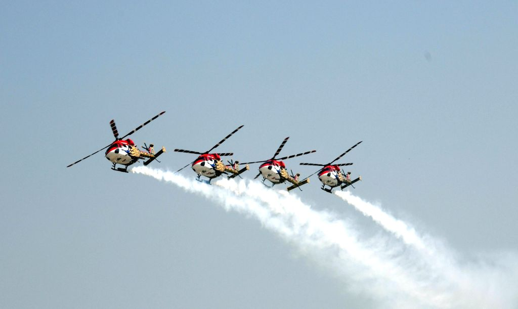 IAF's Sarang Helicopter Display team showcases aerial maneuvers during 88th Air Force Day Parade celebrations at Hindon Air Force Station in Ghaziabad, Uttar Pradesh on Oct 8, 2020.
