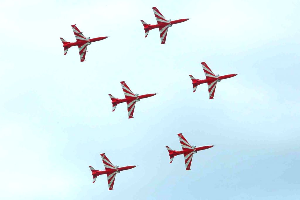 IAF's Surya Kiran aircrafts display manoeuvre during an air show organised to commemorate 20th Anniversary of Kargil Vijay Diwas at the Indian Air Force Station in Hakeempet, Hyderabad on ...