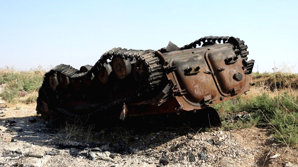 IDLIB (SYRIA), Aug. 15, 2019 A burned tank is seen in the southern countryside of Idlib province, northwestern Syria, on Aug. 15, 2019. The Syrian army will storm the key town of Khan ...