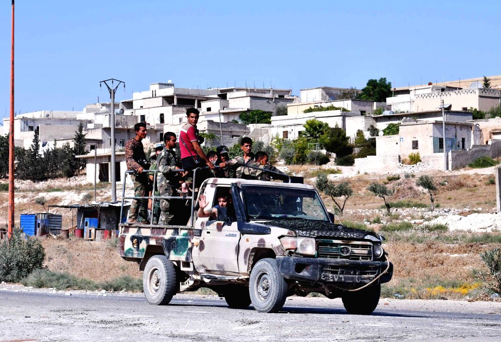 IDLIB (SYRIA), Aug. 24, 2019 Syrian soldiers are seen in the town of Khan Shaykhun in the southern countryside of Idlib province, Syria, on Aug. 24, 2019. The Syrian army on Friday fully ...