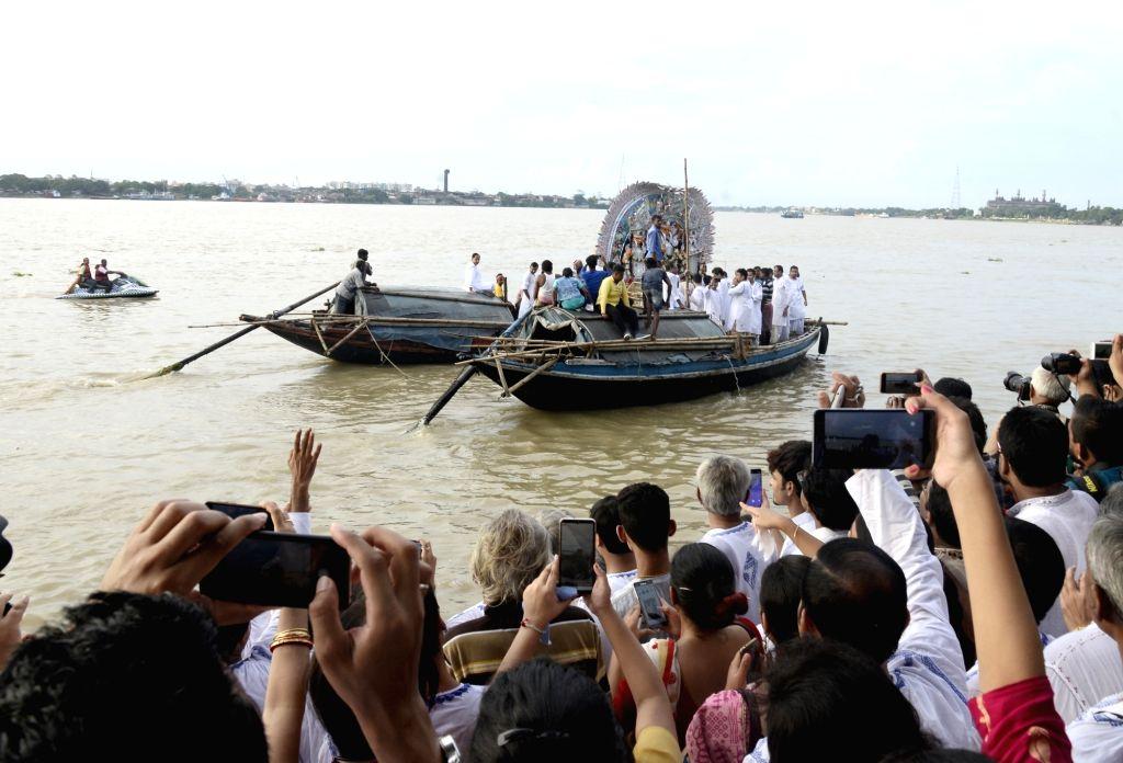 Idol of Goddess Durga from Sovabazar Rajbari Puja pandal being taken for immersion during Vijaya Dashami celebrations, in Kolkata on Oct 8, 2019.