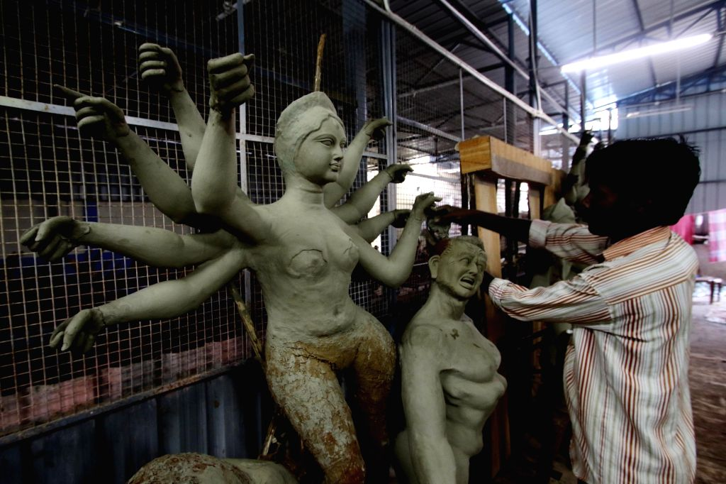 Idols of Goddess Durga being prepared at a Chennai workshop ahead of Durga Puja celebrations, on Oct 7, 2020.