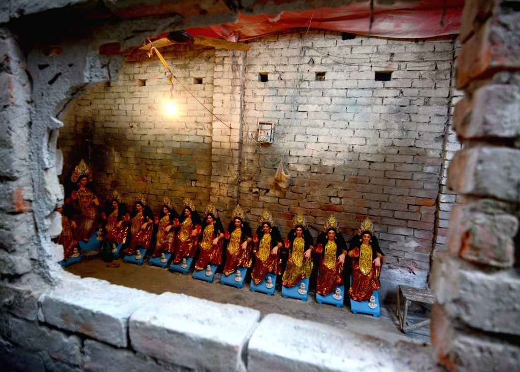 Idols of Goddess Laxmi at the Kumartuli workshop on the eve of Laxmi Puja celebrations in Kolkata on Oct 29, 2020.