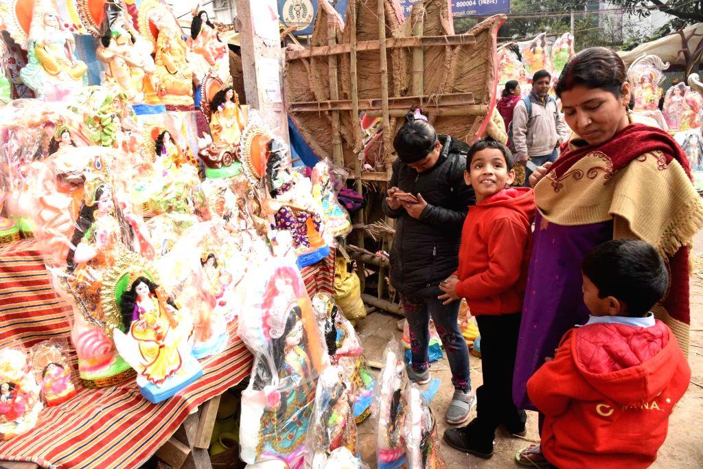 Idols of Goddess Saraswati on sale at a street-side market ahead of Saraswati Puja celebrations, in Patna on Jan 28, 2020.