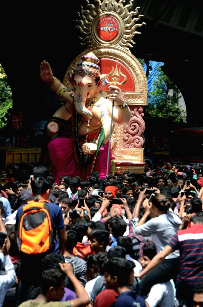 Idols of Lord Ganesha being taken to their respective pandals ahead of Ganesh Chaturthi, in Mumbai on Sept 8, 2018.