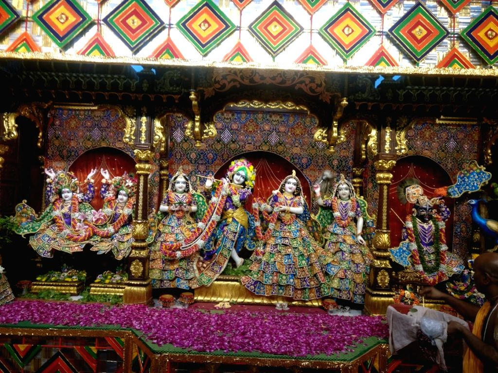 Idols of Lord Krishna and Radha adorned in specially designed dresses at ISKCON Chowpatty during Janmashthami celebrations, in Mumbai on Aug 24, 2019. The morning dresses specially designed ...
