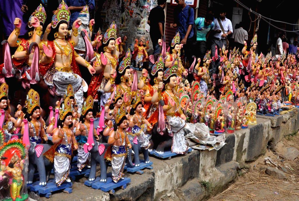 Idols of lord Vishwakarma being sold at a roadside stall ahead of Vishwakarma puja in Guwahati on Sept 16, 2016.