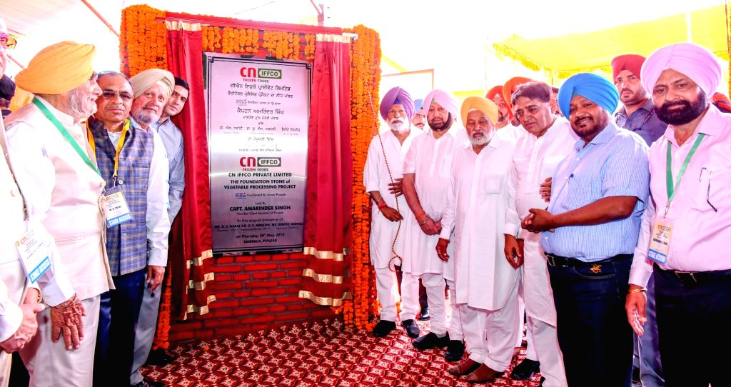IFFCO Chairman B. S. Nakai and Punjab Chief Minister Captain Amarinder Singh unveil the plaque to lay the foundation stone for a vegetable processing project in Punjab's Ludhiana, on May ... - Captain Amarinder Singh