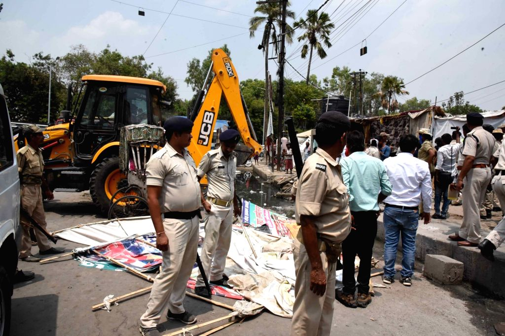 Illegal encroachments being demolished at Ramgulam in Patna, on June 14, 2019.