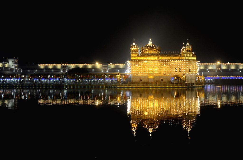 illuminated  Golden temple on the eve of birth anniversary of the 10th Sikh Guru Gobind Singh, in Amritsar, Tuesday, Jan 19, 2021. - Guru Gobind Singh