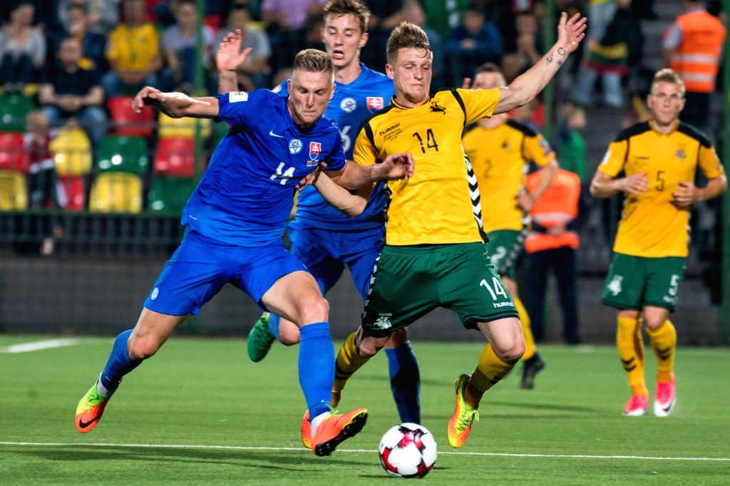 ILNIUS, June 11, 2017 - Vykintas Slivka (R) of Lithuania vies with Filip Kiss (L) of Slovakia during the FIFA World Cup European Qualifying Group F match between Lithuania and Slovakia at LFF Stadium ...