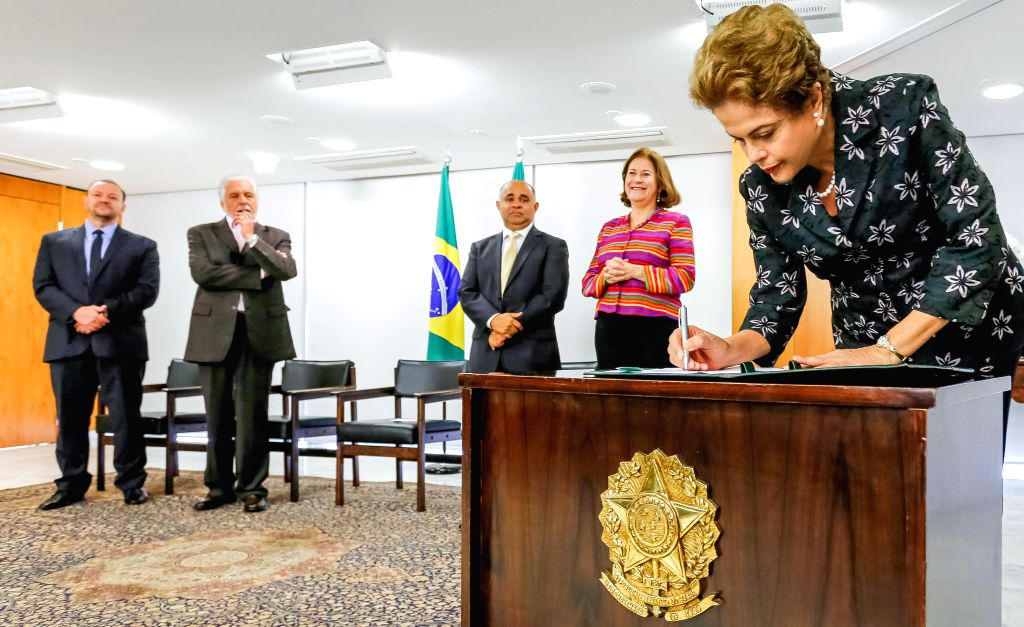 Image provided by Brazil's Presidency shows Brazilian President Dilma Rousseff (R) participating in the signing ceremony of soccer sponsorship contracts, in the ...