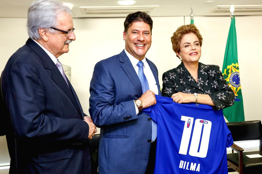 Image provided by Brazil's Presidency shows Brazilian President Dilma Rousseff (R) posing during the signing ceremony of soccer sponsorship contracts, in the ...