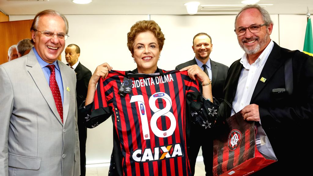 Image provided by Brazil's Presidency shows Brazilian President Dilma Rousseff (C) posing during the signing ceremony of soccer sponsorship contracts, in the ...
