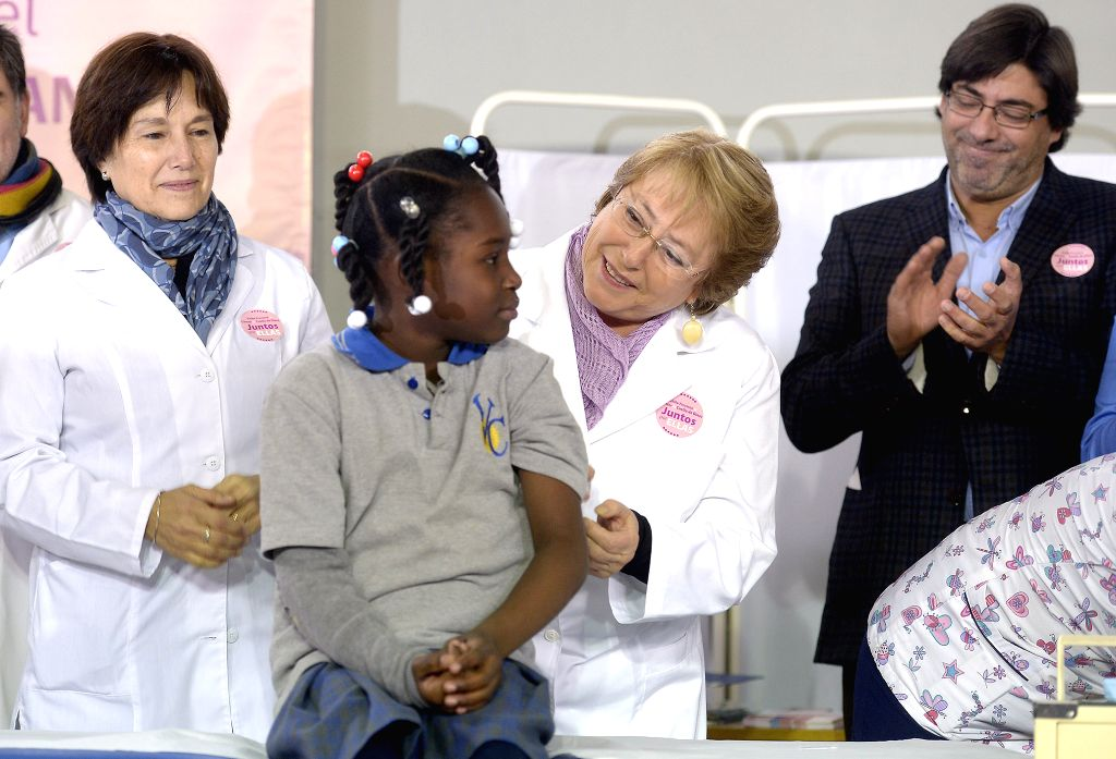 Image provided by Chile's Presidency shows Chilean President Michelle Bachelet (2nd R) attending the ceremony of the 2015 vaccination process against human ...