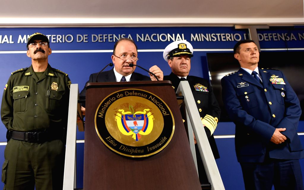 Image provided by Colombia's Ministry of Defense shows Colombian Minister of Defense Luis Carlos Villegas (2nd L) participating in a press conference about the ...