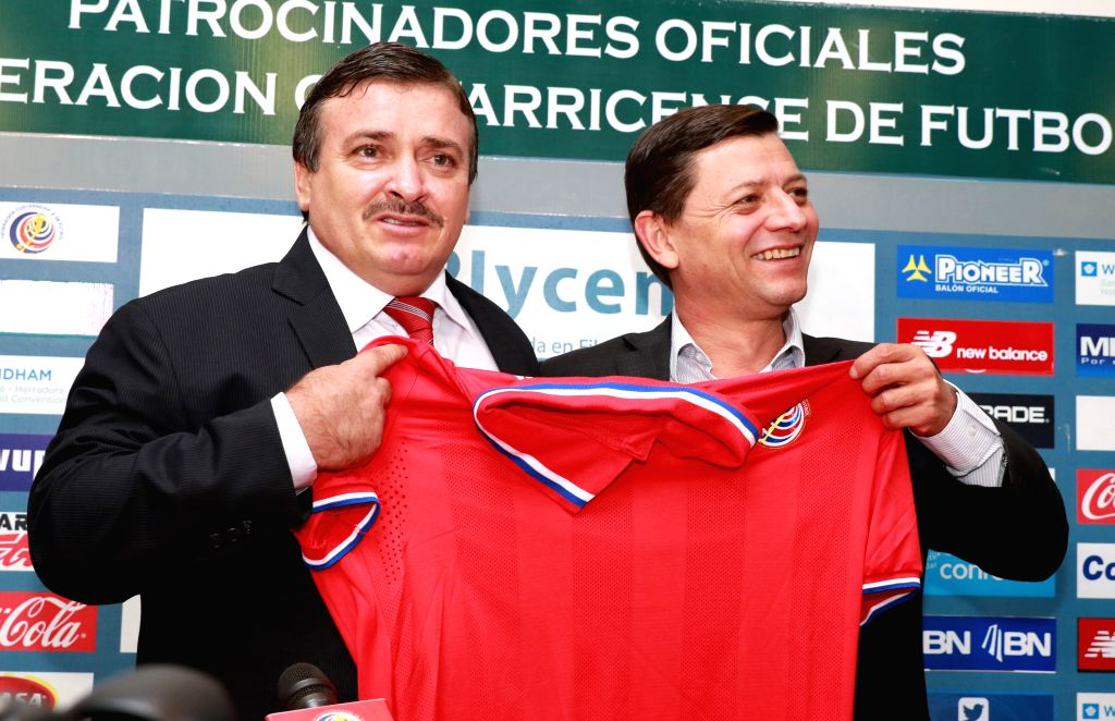 Image provided by the Costa Rican Soccer Federation (FEDEFUT) shows new head coach of Costa Rica's national soccer team Oscar Ramirez (L) and FEDEFUT ...