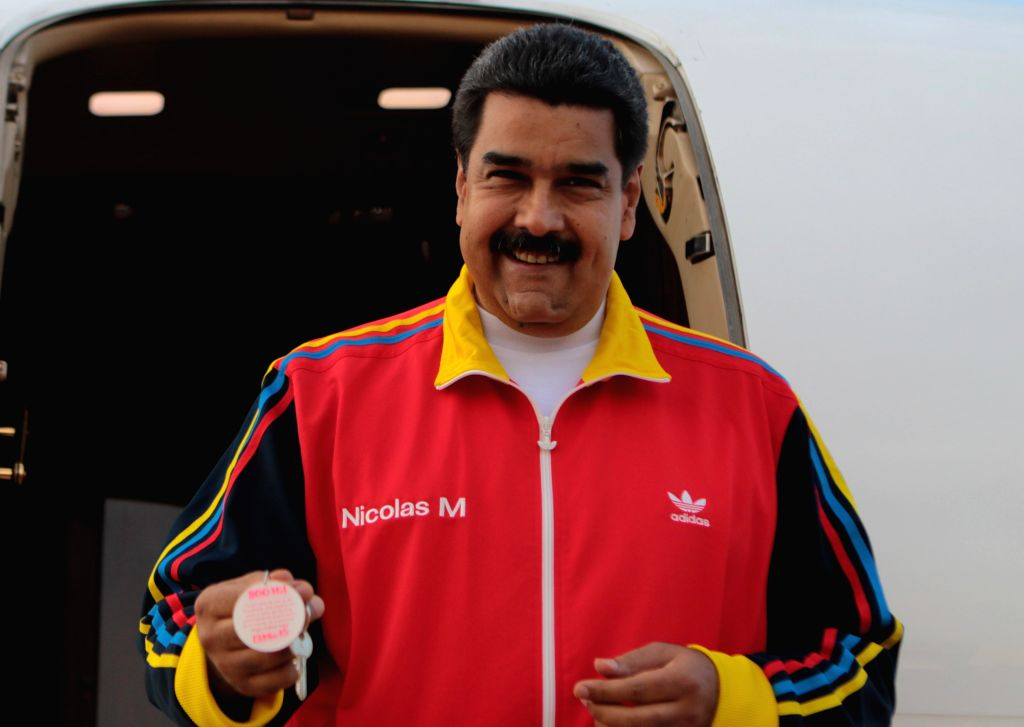 Image provided by Venezuela's Presidency, of Venezuelan President, Nicolas Maduro, attending the delivering ceremony of house number 800,000 of Venezuela Housing ...