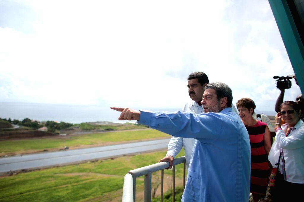 Image provided by Venezuela's Presidency shows Venezuelan President, Nicolas Maduro (L-back), supervising the construction of the Argyle International Airport, ...