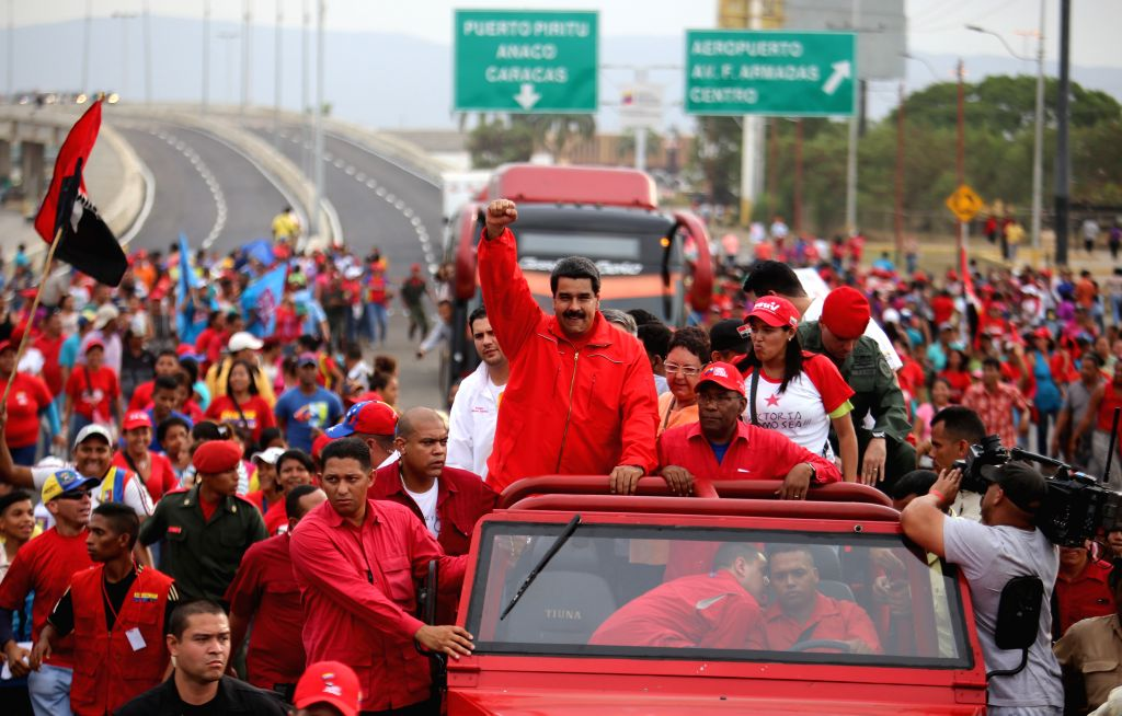 Image provided by Venezuela's Presidency shows Venezuelan President Nicolas Maduro (C), greeting to attendees during the opening of the traffic solution number ...