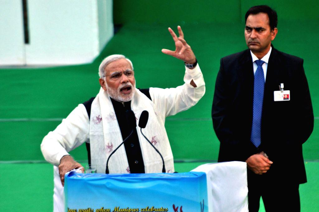Prime Minister Narendra Modi addresses at the closing ceremony of Sangai Festival at Bheigyachandra Open Air Theatre in Imphal on Nov 30, 2014. - Narendra Modi