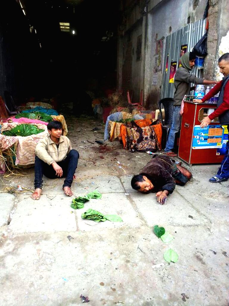 The injured at the site of a bomb blast near Delhi Motor Store in Imphal on Dec 15, 2014. One person was killed and five others seriously injured in the blast.