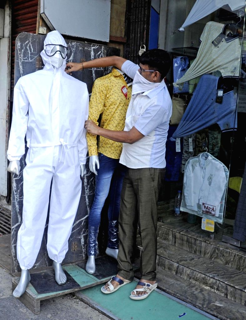 In a unique gesture to sensitise the public to Covid-19 crisis, many shopkeepers in West Bengal's Birbhum district have put up mannequins sporting face masks and PPE kits in the show ...