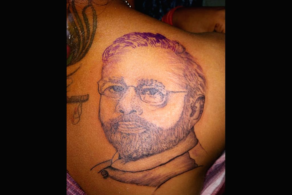In an a move to celebrate the Union Government's decision to abrogate Article 370 of the Constitution and to give Jammu and Kashmir a Union Territory status, a girl in Jharkhand's capital Ranchi got a tattoo of Prime Minister Narendra Modi on her bac - Narendra Modi