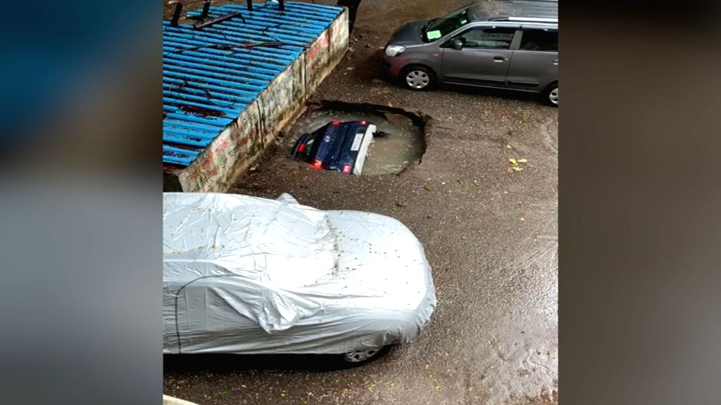 In depth disappearance: Car vanishes down well in Mumbai