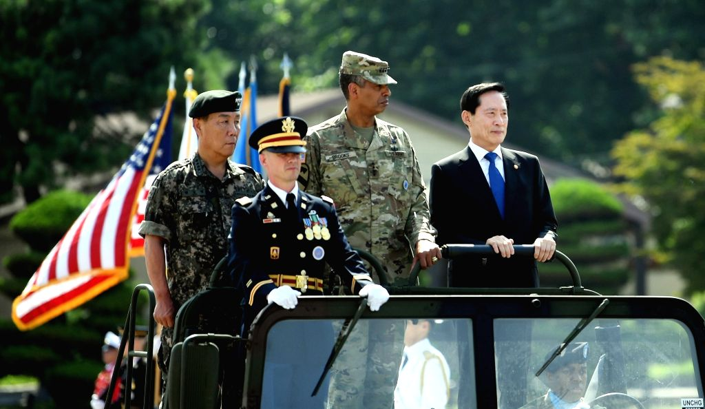 In this photo courtesy of the Defense Ministry, South Korean Defense Minister Song Young-moo, escorted by Gen. Vincent K. Brooks, who commands the U.S. Forces Korea (USFK) and Korea-U.S. Combined ... - Song Young