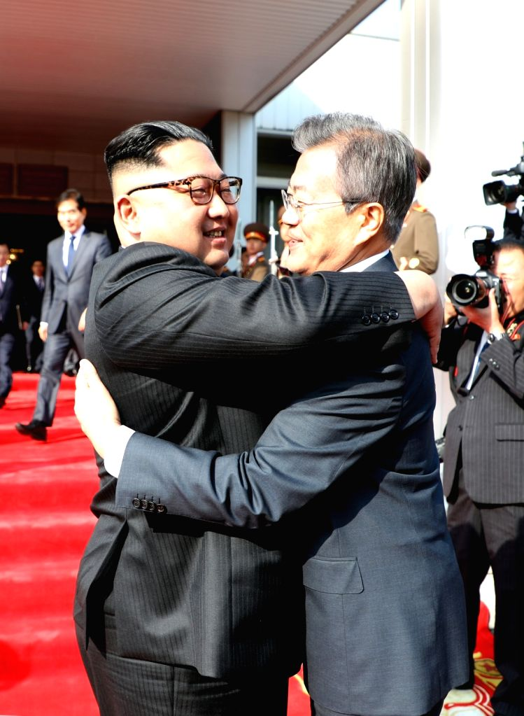 In this photo provided by Cheong Wa Dae, North Korean leader Kim Jong-un (L) hugs South Korean President Moon Jae-in after their summit at Tongilgak on the northern side of Panmunjom in ...