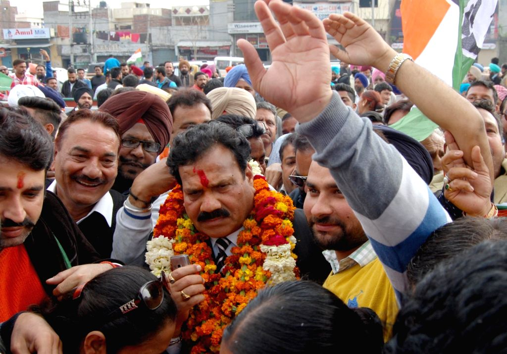 INC candidate Raj Kumar Verka celebrates after his victory in Punjab Assembly elections in Amritsar on March 11, 2017. - Kumar Verka