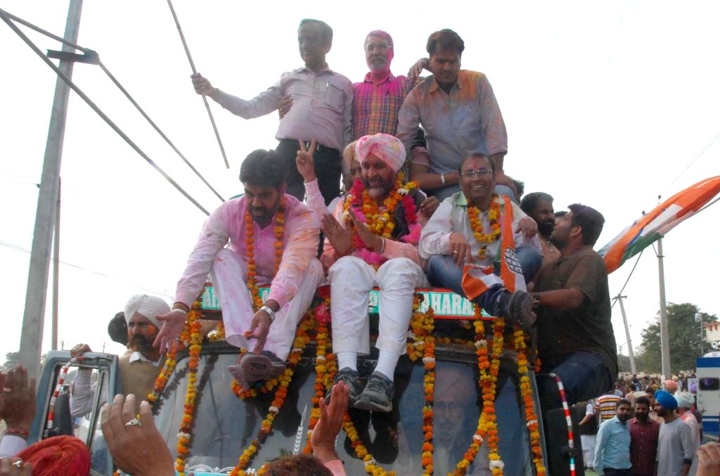 INC's candidate Manpreet Singh Badal celebrates after his victory in Punjab Assembly elections in Bathinda on March 11, 2017. - Manpreet Singh Badal