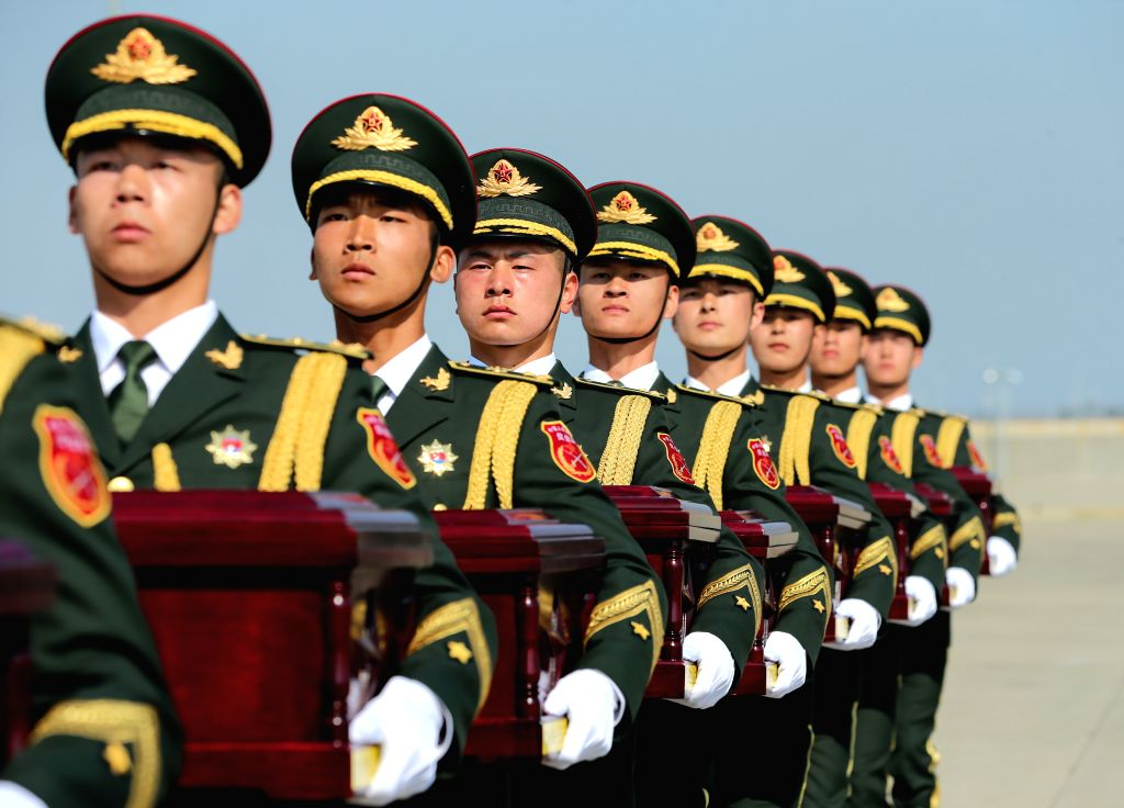 INCHEON, April 3, 2019 - Chinese soldiers carry to a plane coffins containing remains of martyrs of the Chinese People's Volunteers killed in the 1950-53 Korean War, during a transfer ceremony at ...