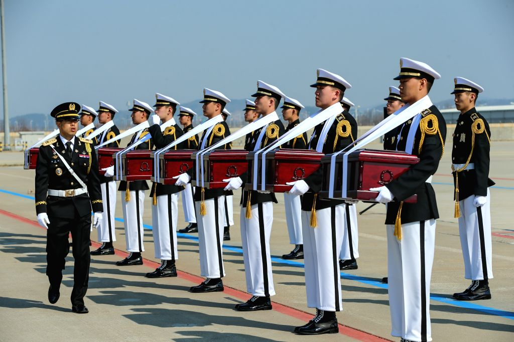 INCHEON, April 3, 2019 - South Korean troops carry coffins containing remains of martyrs of the Chinese People's Volunteers (CPV) killed in the 1950-1953 Korean War, during a transfer ceremony at the ...