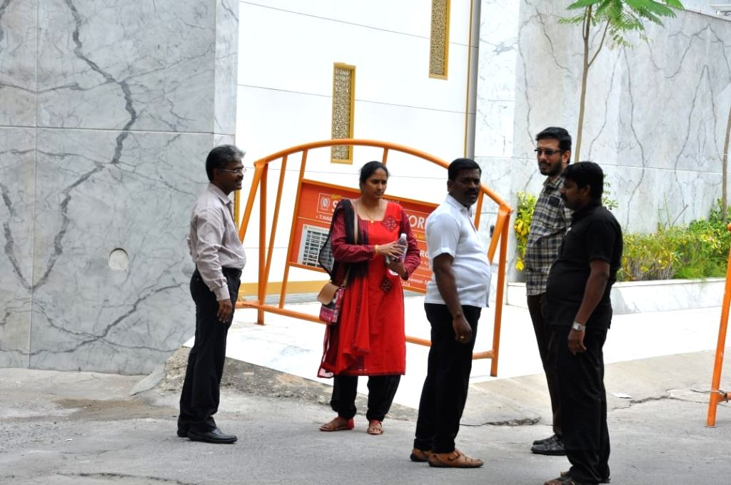 Income Tax (IT) officials outside a Saravana store where IT raids are underway in Chennai, on Jan 29, 2019.