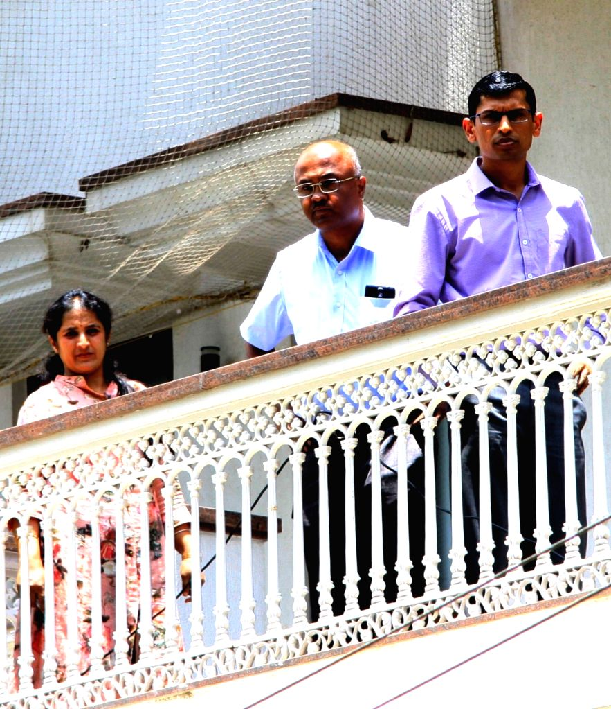 Income Tax officials at the residence of Karnataka Energy Minister DK Shivakumar during the Income Tax department raids in Bengaluru on Aug 2, 2017. - D