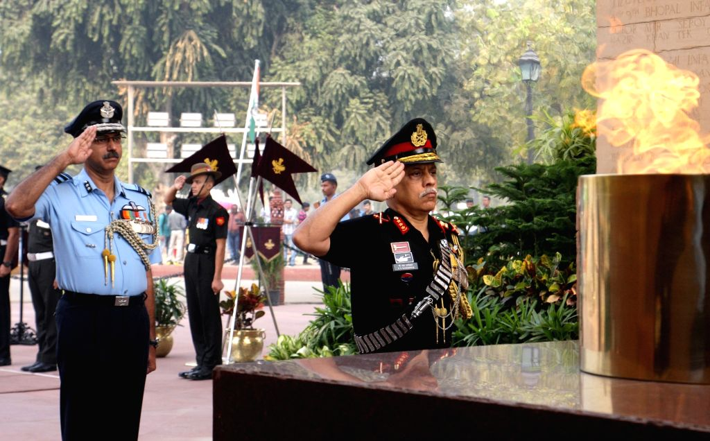 Incumbent Chief of Integrated Defence Staff to Chairman COSC, Lt. Gen. P.S. Rajeshwar pays homage to the martyrs, at Amar Jawan Jyoti, India Gate, in New Delhi on Nov. 1, 2018.