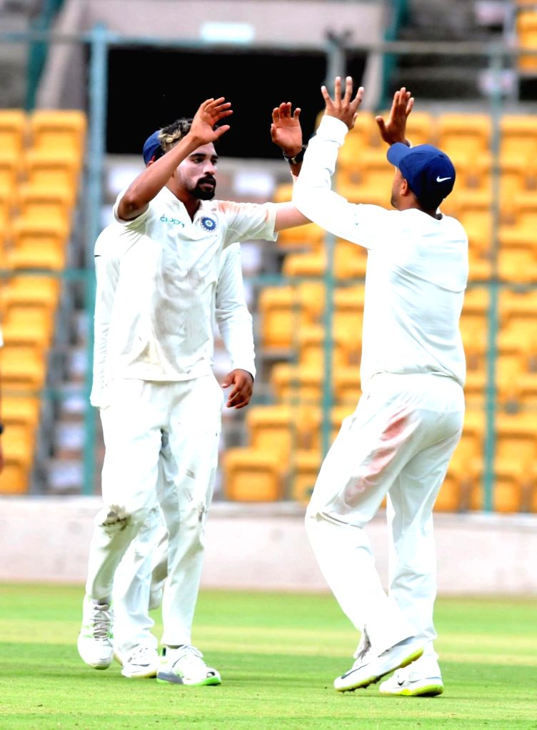 India A players celebrates fall of Rudi Second's wicket on 1st day of the four day test match between India A and South Africa A at M Chinnaswamy Stadium, in Bengaluru on Aug 4, 2018.