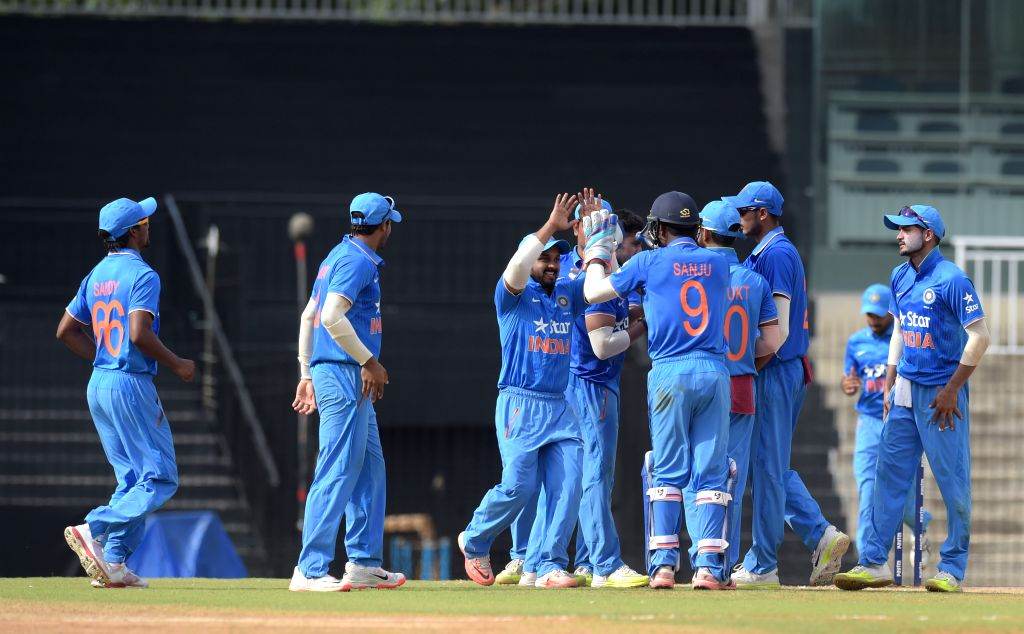 India `A` team players celebrate falll of a wicket during India A Team Triangular Series match between India `A` and Australia `A` at MAC Stadium in Chennai, on Aug 10, 2015.