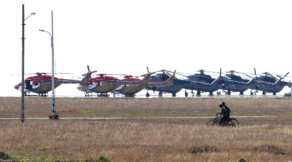 India Air Forces (IAF) Dhruv and ALH helicopters parked at the runway ahead of the 12th edition of AERO India 2019 at Yelahamka Airbase, in Bengaluru on Feb 14, 2019.