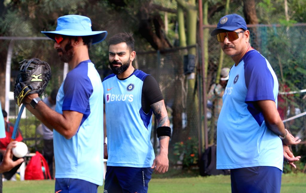 India coach Ravi Shastri, batting coach Vikram Rathour and skipper Virat Kohli during a practice session ahead of the first Twenty20 match against West Indies at Rajiv Gandhi International ... - Virat Kohli