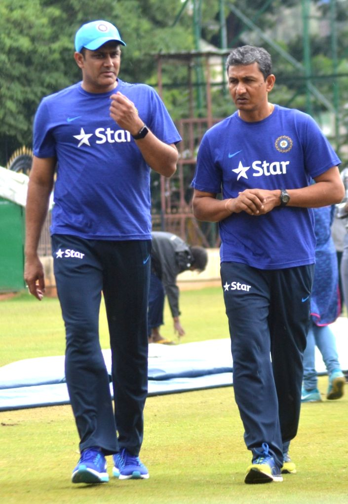 India cricket team head coach Anil Kumble and batting coach Sanjay Bangar during the team preparatory camp before its tour to West Indies at Chinnaswamy Stadium, in Bengaluru on June 29, ...