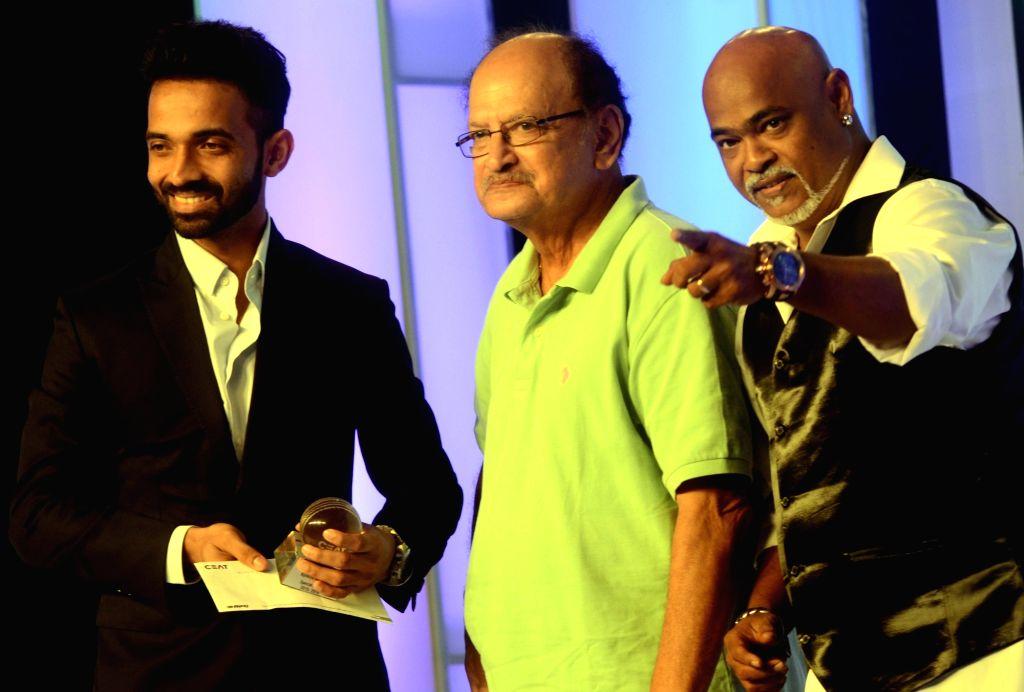 India cricketer Ajinkya Rahane and former India cricketer Vinod Kambli during the CEAT award function in Mumbai on May 30, 2016.