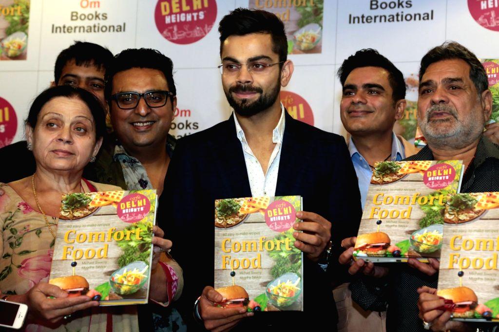 "India cricketer Virat Kohli releasing the cook book ""Comfort Food"" in New Delhi on May 31, 2016. - Virat Kohli"