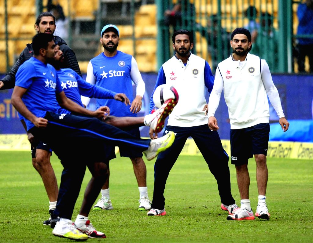 India cricketers R Ashwin, Virat Kohli, Ishant Sharma and Murali Vijay warm up on the ground as rain delay the start of the 4th day of the second test match between India and South Africa ... - Virat Kohli and Ishant Sharma