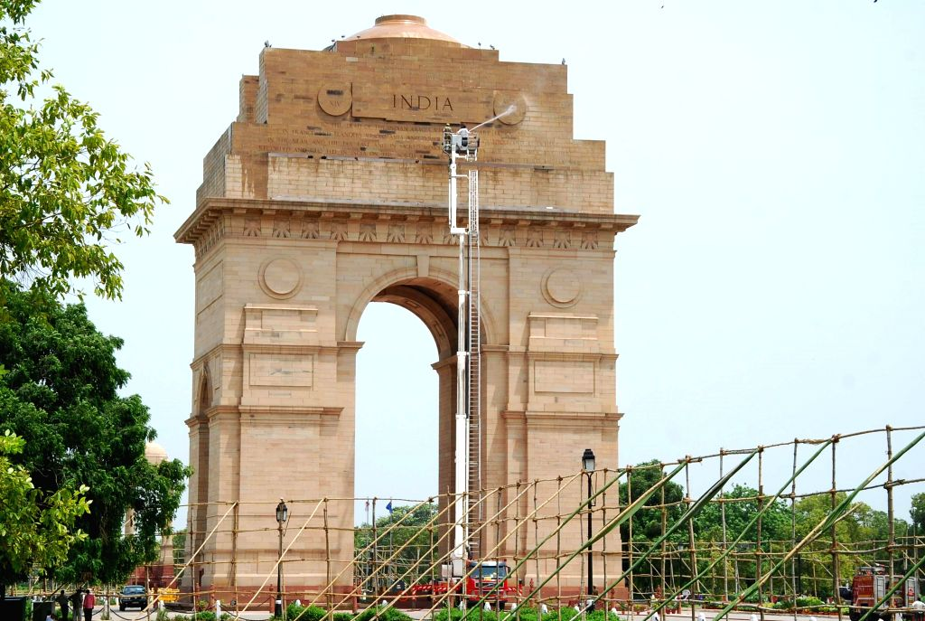 India Gate being cleaned ahead of `Independence Day` in New Delhi on Aug 13, 2014.